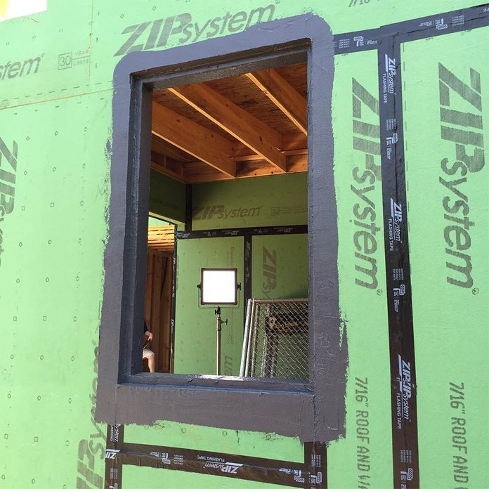 An empty pocket for a window covered in liquid flashing | Construction Pro Tips
