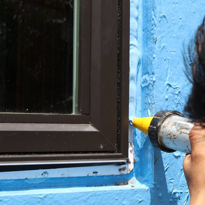 Sealing the window in place after it has been installed | Construction Pro Tips