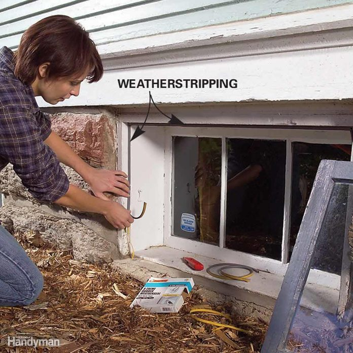 Woman adds weatherstripping to an egress window