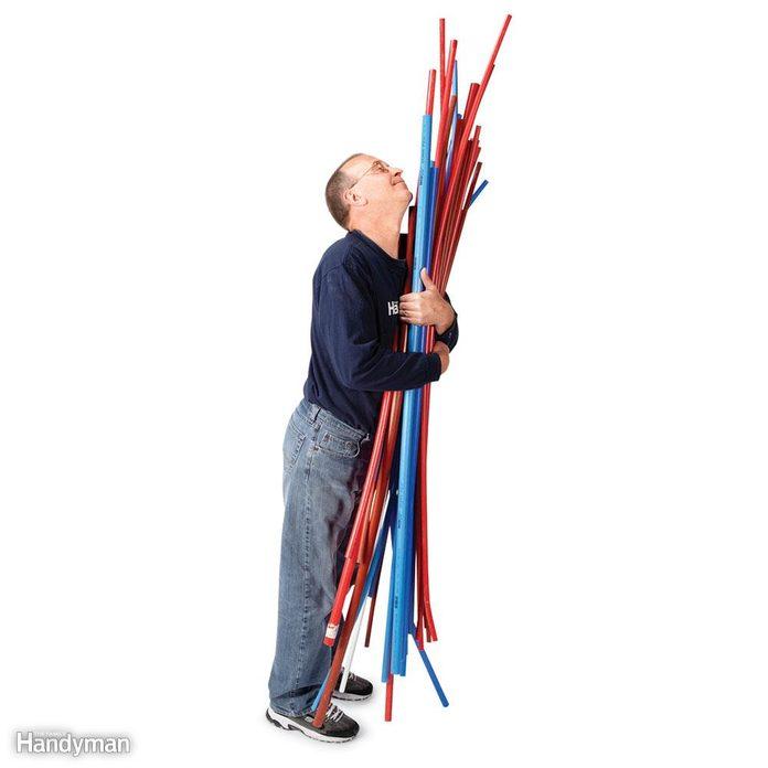 Man holding PEX piping