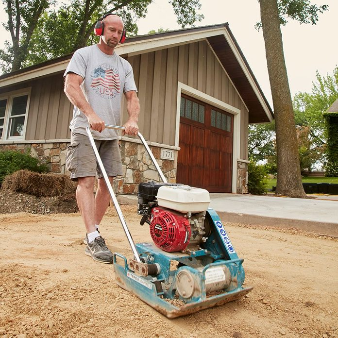 Tamping down the concrete base | Construction Pro Tips