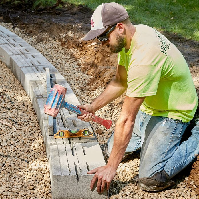 Creating a level block base for a stone retaining wall   Construction Pro Tips