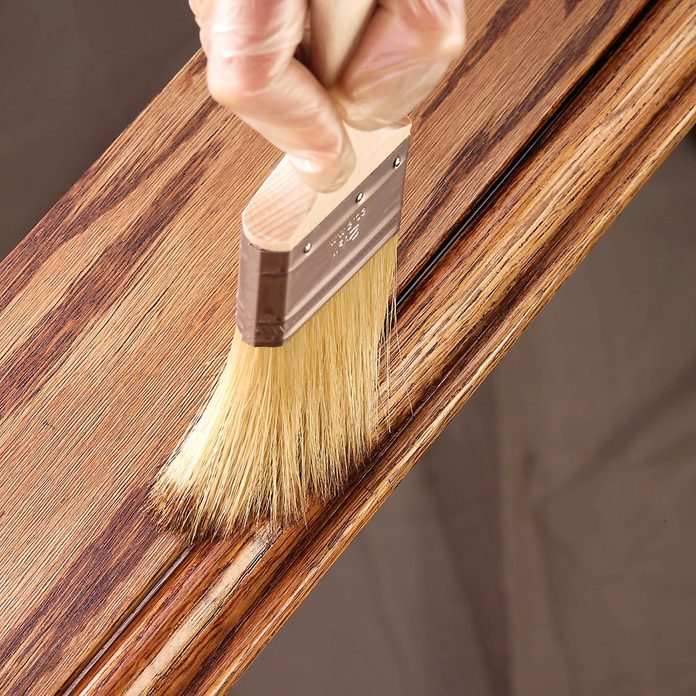 Applying stain with a dry brush | Construction Pro Tips