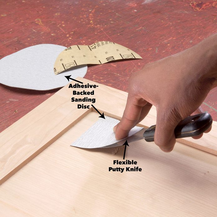 putty knife to sand tight spots