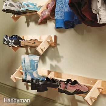 shoes rest on a wooden shoe rack
