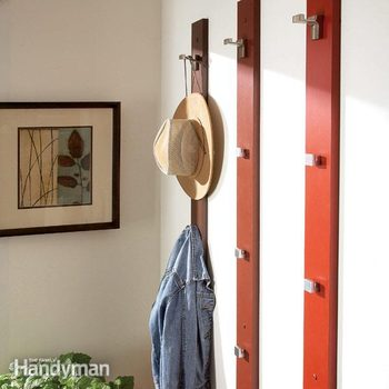 a hat and coat hang from a wood coat and hat rack