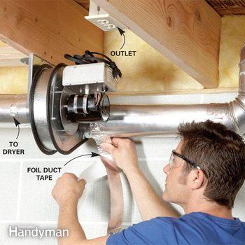 Man installs a dryer duct booster fan