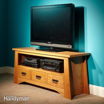 A TV sits on an elegant wooden TV stand