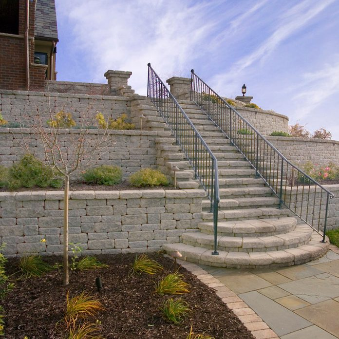 A retaining wall with tiers   Construction Pro Tips
