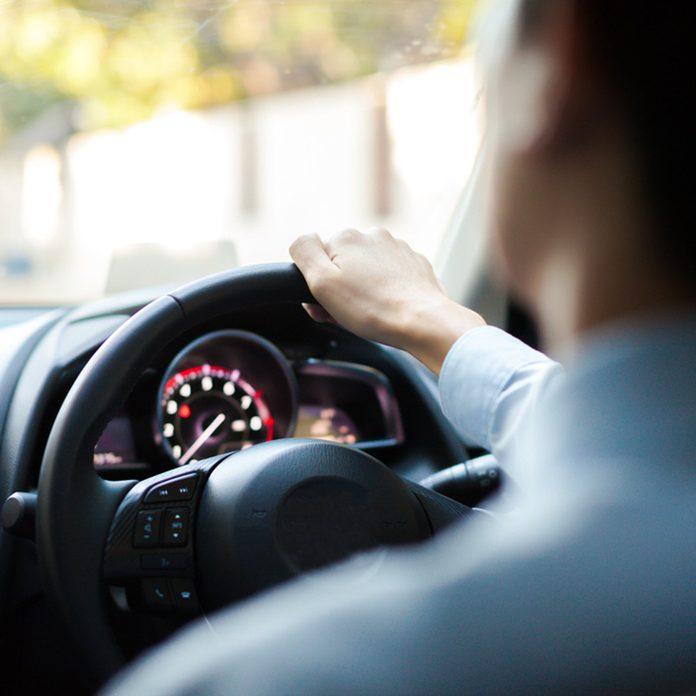 man drives a car