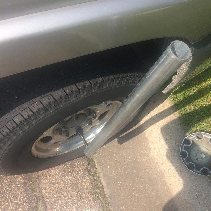 breaker bar to loosen lug nuts on flat tire
