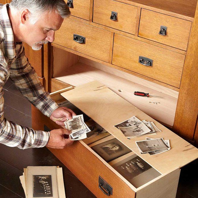 false bottom bookcase of secrets