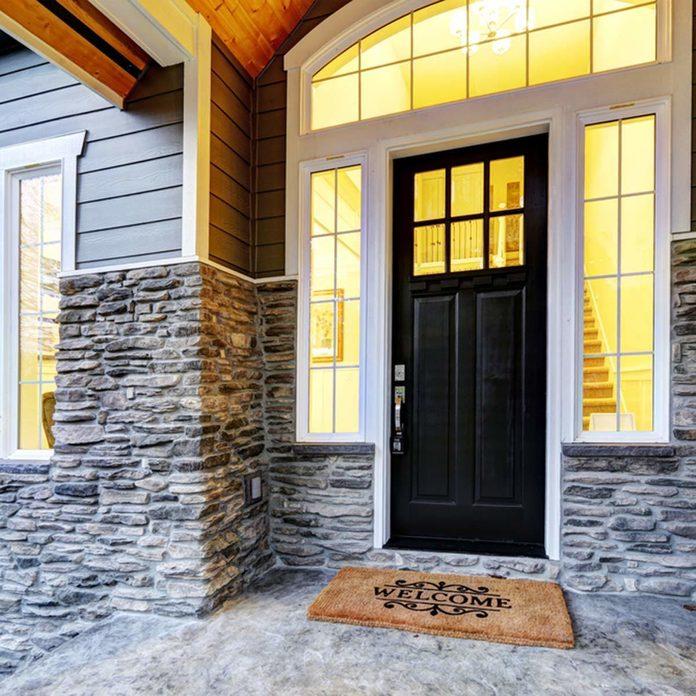 black front door stone work exterior