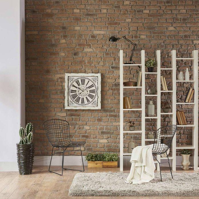 natural brick wall loft bookshelves