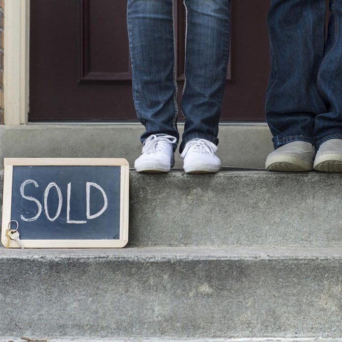 front stoop sold sign house home real-estate