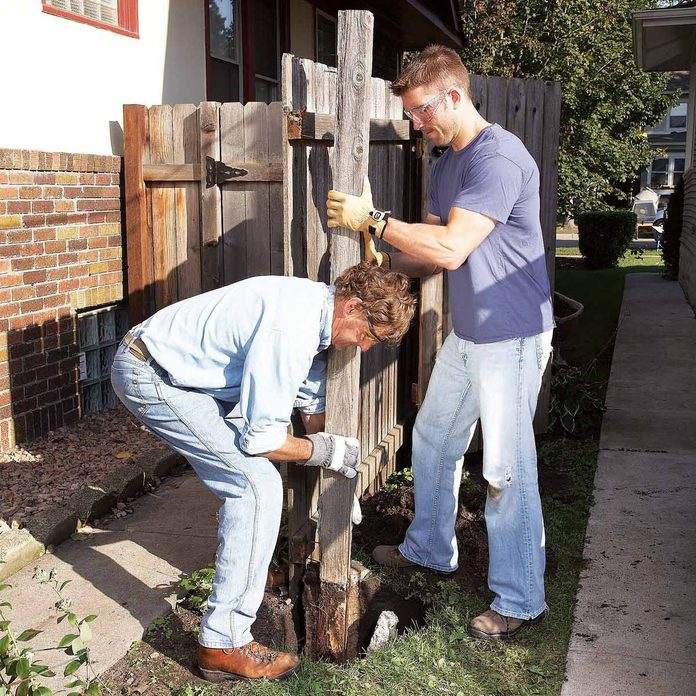 FH09MAR_496_05_047 digging a hole for a fence post checking for rot