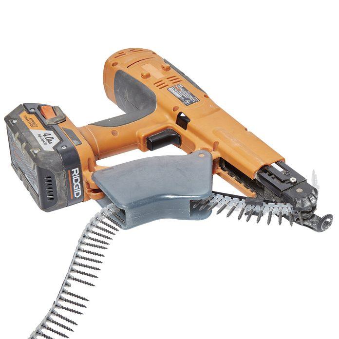 Self-feeding drywall screw gun