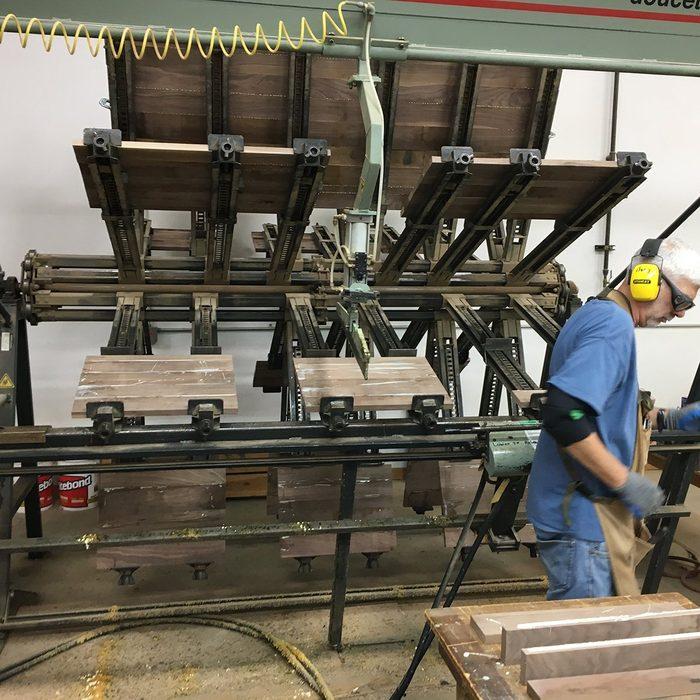 A machine gluing coffins   Construction Pro Tips