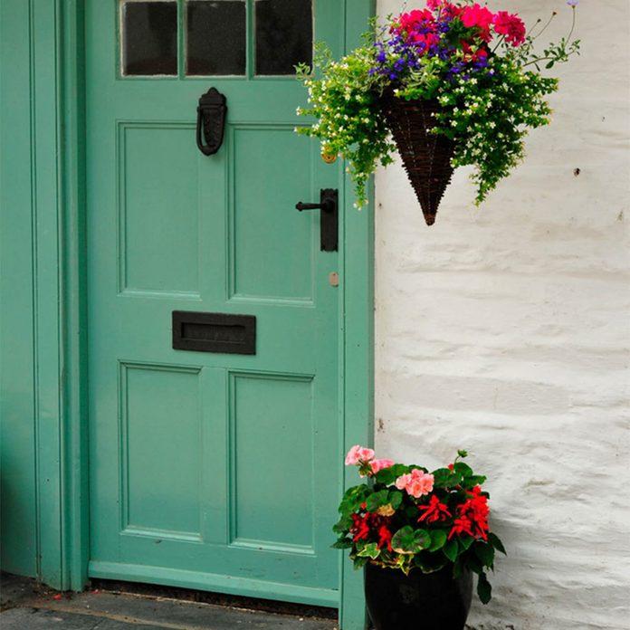dfh17jul019-9-shutterstock_56486248-1200x1200 new front door curb appeal resale value hanging flowers