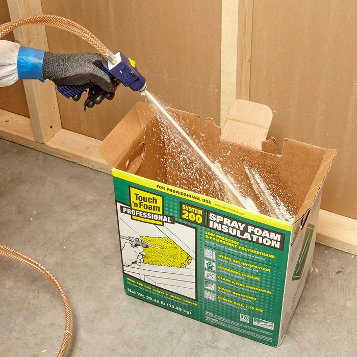 Spraying foam into a box to remove build-up   Construction Pro Tips