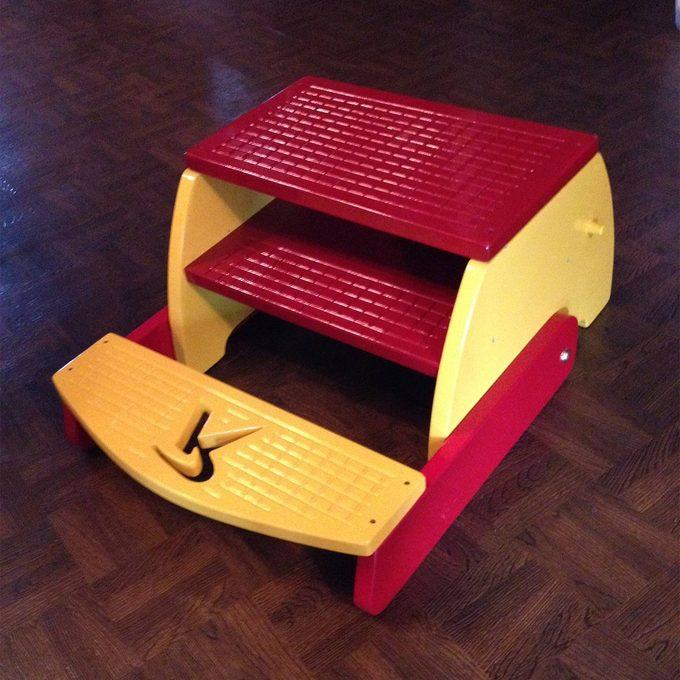 reader flip flop stool folded down
