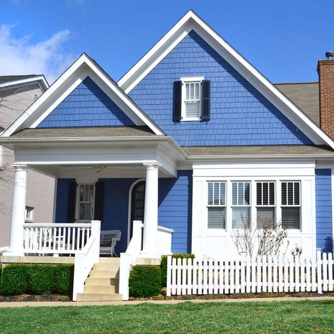 shutterstock_121617061 buying first home blue house with white trim front porch