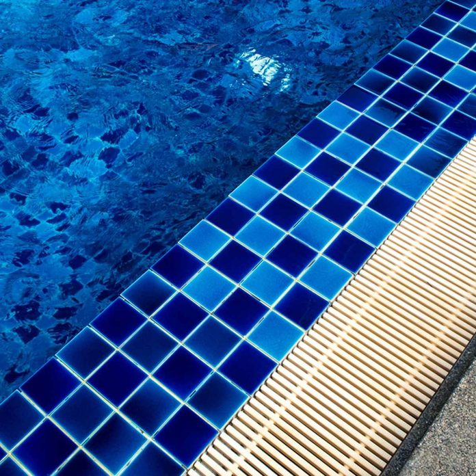 in-ground pool tile and grain gate