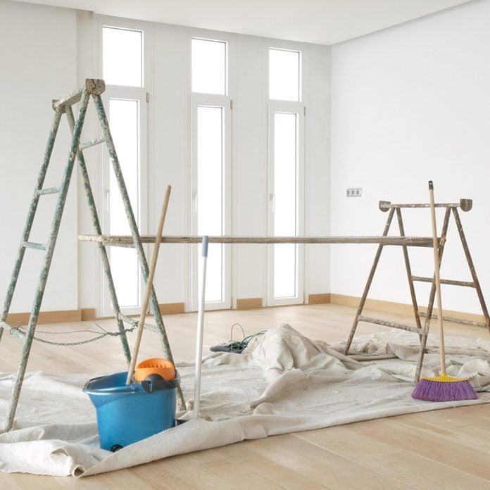 shutterstock_75276847 interior paint prep ladders tarp