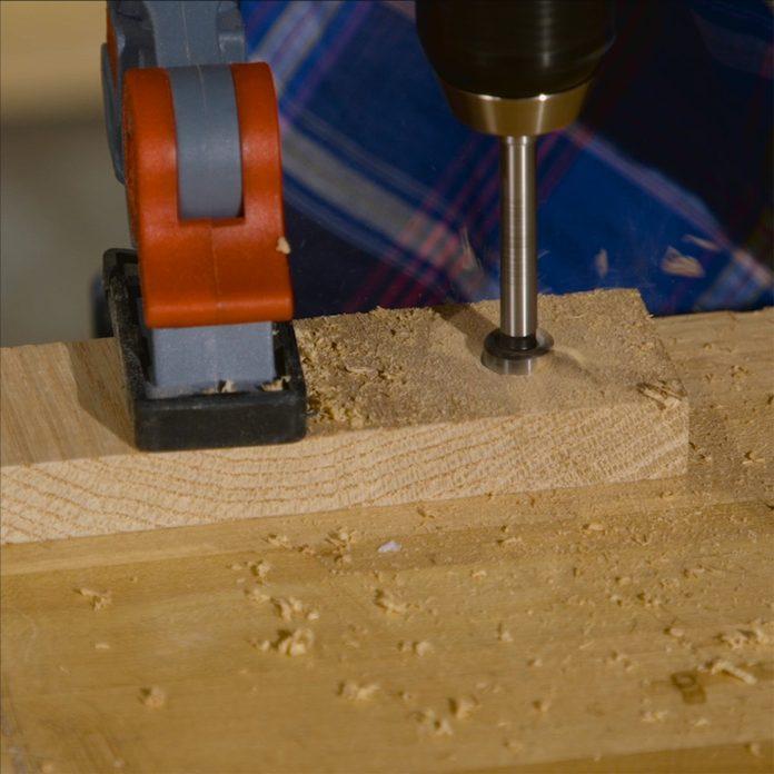 tablet stand forstner bit drilling up close