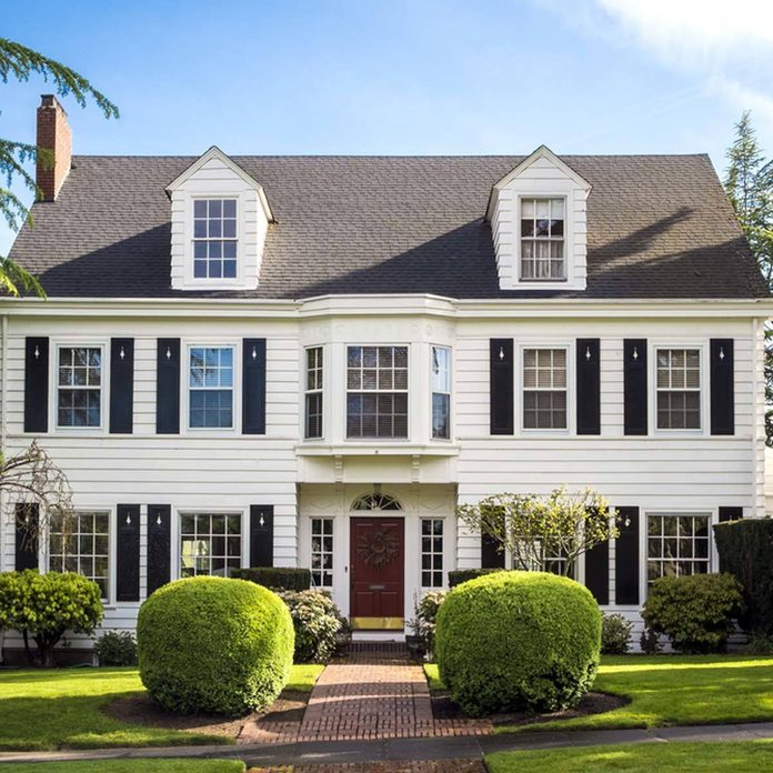 white colonial home house with shutters