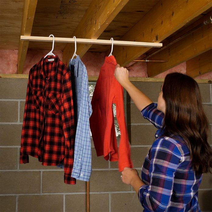 hanging clothes on drying rack