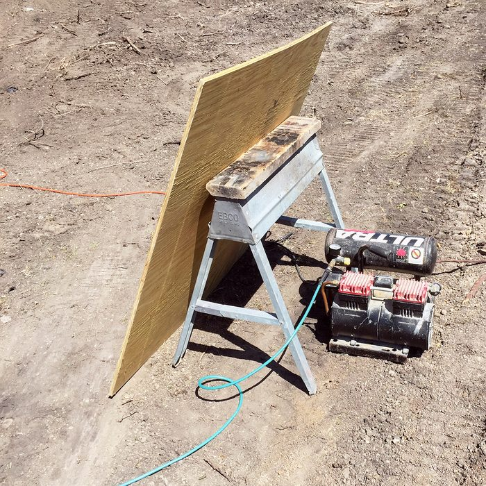 Board placed in front of compressors to block noise | Construction Pro Tips