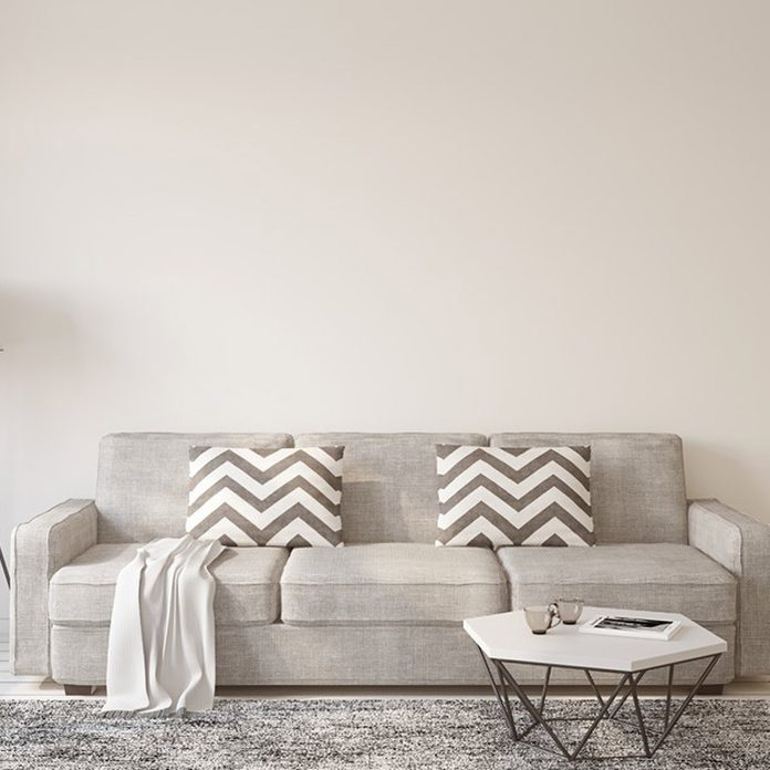 dfh17jul034_520261186_06 gray couch light color wall paint chevron pillows grey rug living room