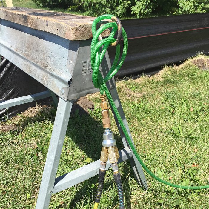 Air hoses hooked around a saw horse | Construction Pro Tips