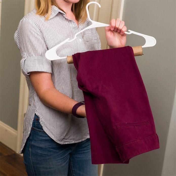 hanging pants on paper towel roll hanger hack