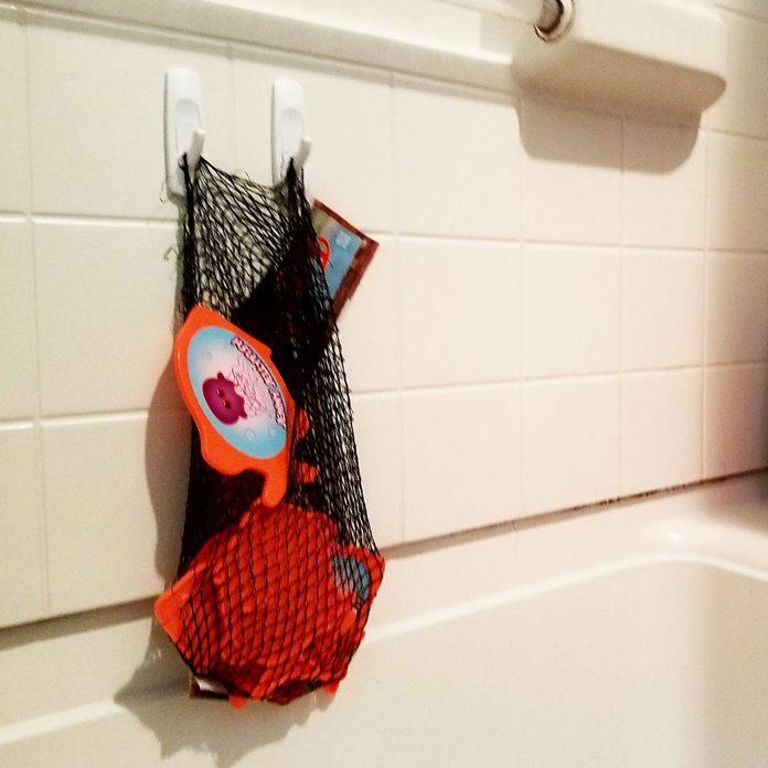 produce-bag bathtub toy storage
