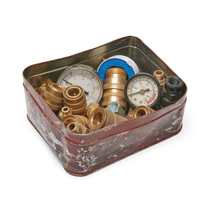 a tin bin full of air compressor parts | Construction Pro Tips
