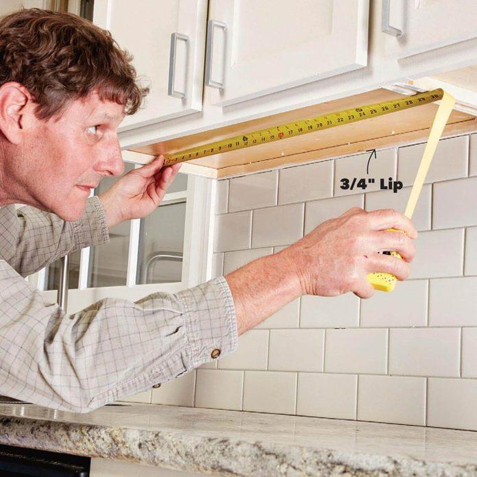 054_FHM_OCTNOV17-1 measure the cabinet bay