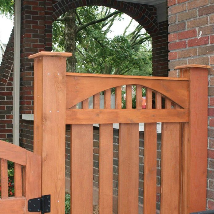 Arched top rails for fence
