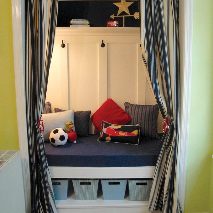 Kids closet transformed to storage and reading space