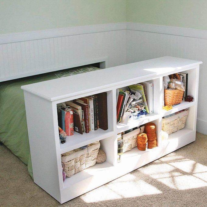 Hidden bed behind bookshelf
