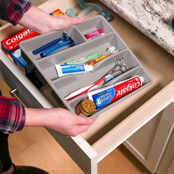 use a silverware organizer in the bathroom