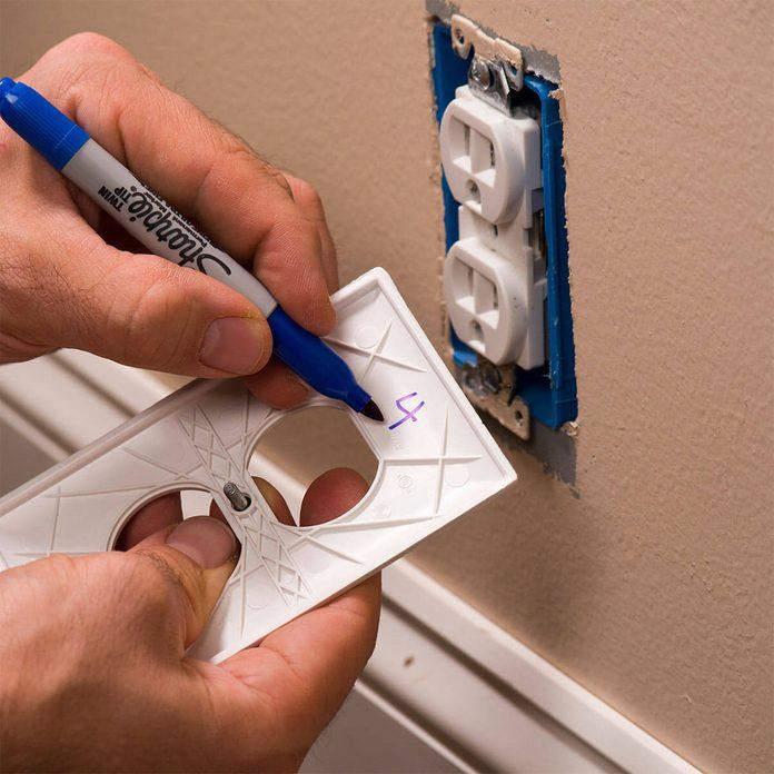 writing breaker number inside outlet cover
