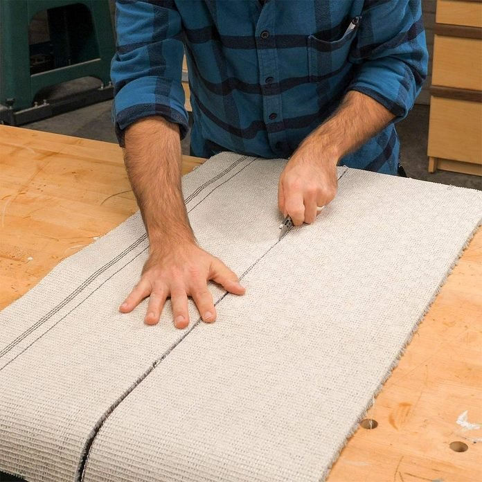 utility knife to cut carpet for sawhorses