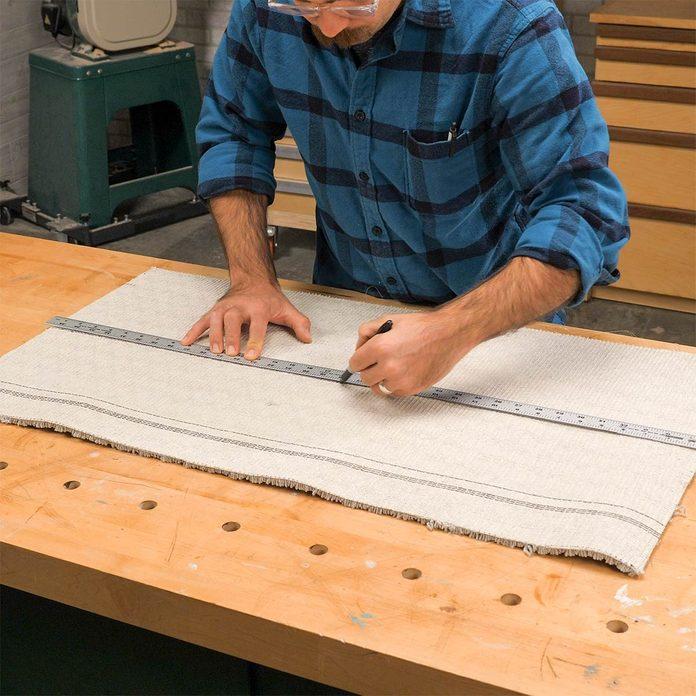 cutting carpet for sawhorses