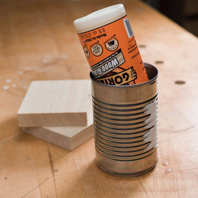 tin can for storing glue bottle upside-down