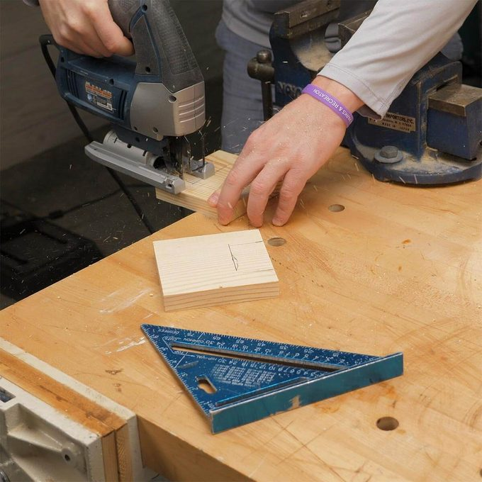 cutting notches in wood blocks for mechanics vise