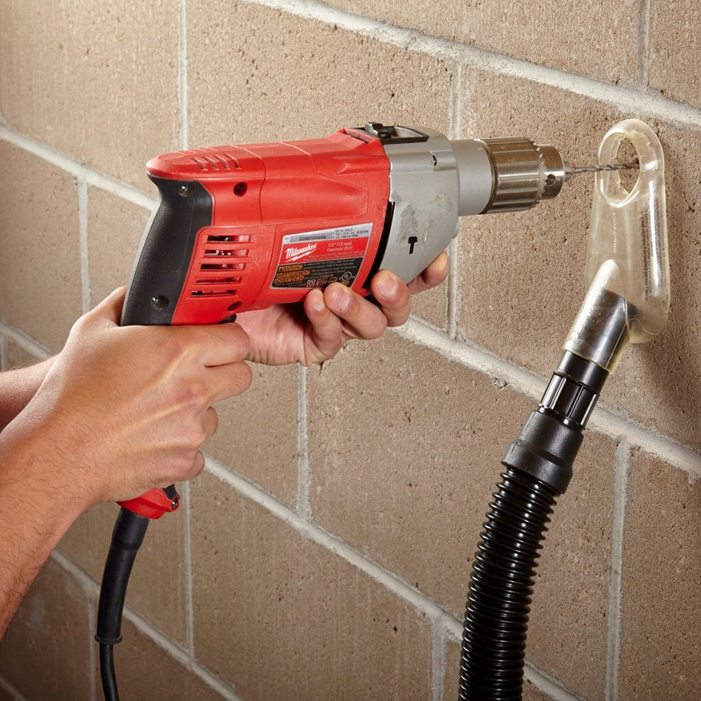 Drilling with a tool designed to immediately suck up dust | Construction Pro Tips