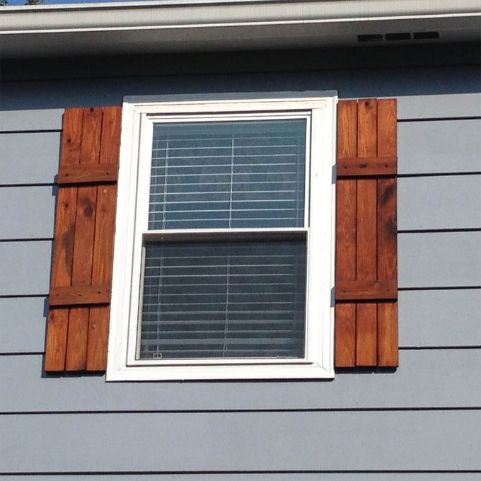 DIY stained shutters on window
