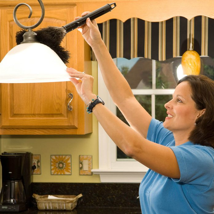 shutterstock_7512736 cleaning dusting light fixture